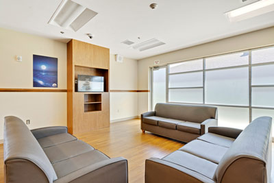 day room with couches at Johnstown Heights Behavioral Health - Colorado mental health and addiction treatment center