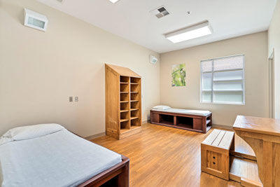client bedroom with light colored wooden furniture - Johnstown Heights Behavioral Healthcare - Colorado dual diagnosis treatment