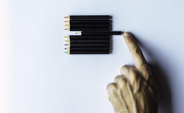 closeup of someone organizing colored pencils - obsessive compulsive disorder